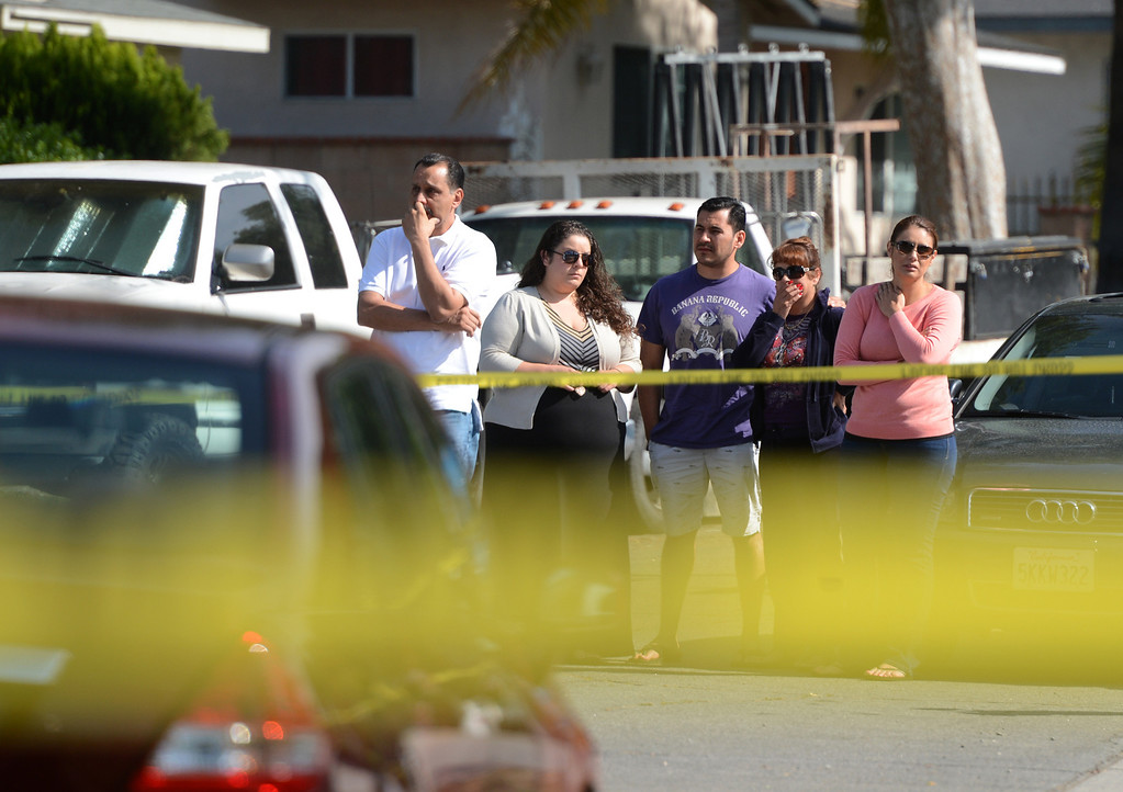 Description of . Family and friends gather at the scene as Pomona Police investigate the scene of a murder-suicide in the 2100 block of north Ramsey Way in Pomona, CA, Friday, May 9, 2014. (Jennifer Cappuccio Maher/Inland Valley Daily Bulletin)
