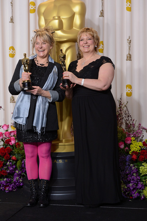 Description of . Julie Dartnell and Lisa Westcott accept the award for best makeup and hairstyling for