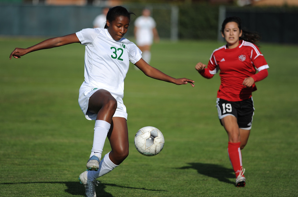 . 02-21-2012--(LANG Staff Photo by Sean Hiller)- South Torrance girls soccer beat Artesia 5-0 in Thursday\'s CIF Southern Section Division IV quarterfinal at South High. Aiyana Canister (32) moves the ball ahead of Artesia\'s Icseel Ortiz (19).