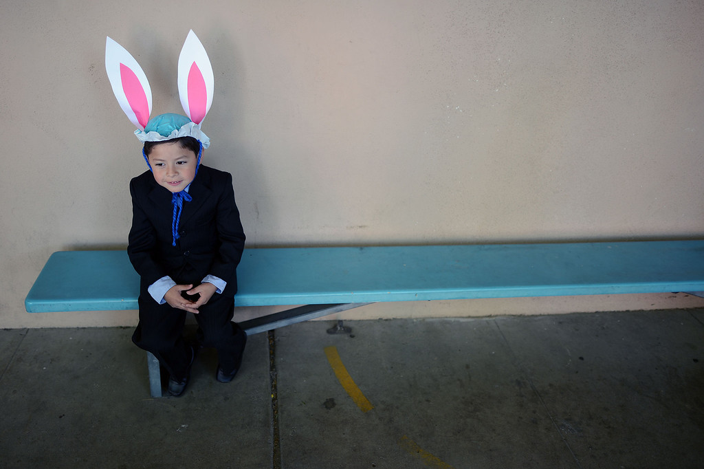. Kindergardener Vincent Alfaro waits to go back to class after participating in the Bertrand Ave. Elementary 40th Kindergarten Spring Bonnet Parade Friday, March 22, 2013 in Reseda. (Hans Gutknecht/Staff Photographer)