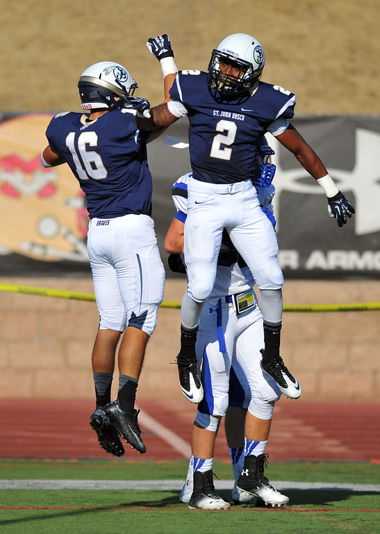 . St. John Bosco football takes on Chandler, Airzona as part of the Mission Viejo Classic in Mission Viejo, CA on Saturday, September 14, 2013. St. John Bosco won 52-31.  Bosco\'s Angelo Quintero (16) celebrates his 1st qtr TD with Jaleel Wadood (2). (Photo by Scott Varley, Press-Telegram)