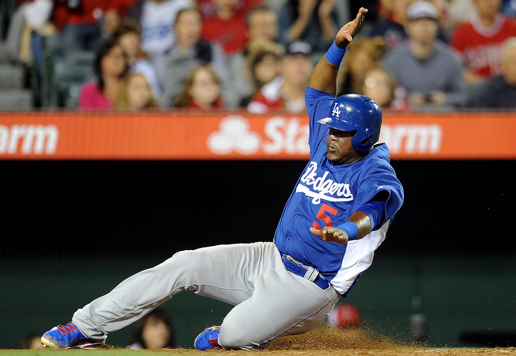 . Los Angeles Dodgers\' Juan Uribe scores on a single by Tim Federowicz (not pictured) in the seventh inning of a spring baseball game on Thursday, March 28, 2012 in Anaheim, Calif.   (Keith Birmingham/Pasadena Star-News)