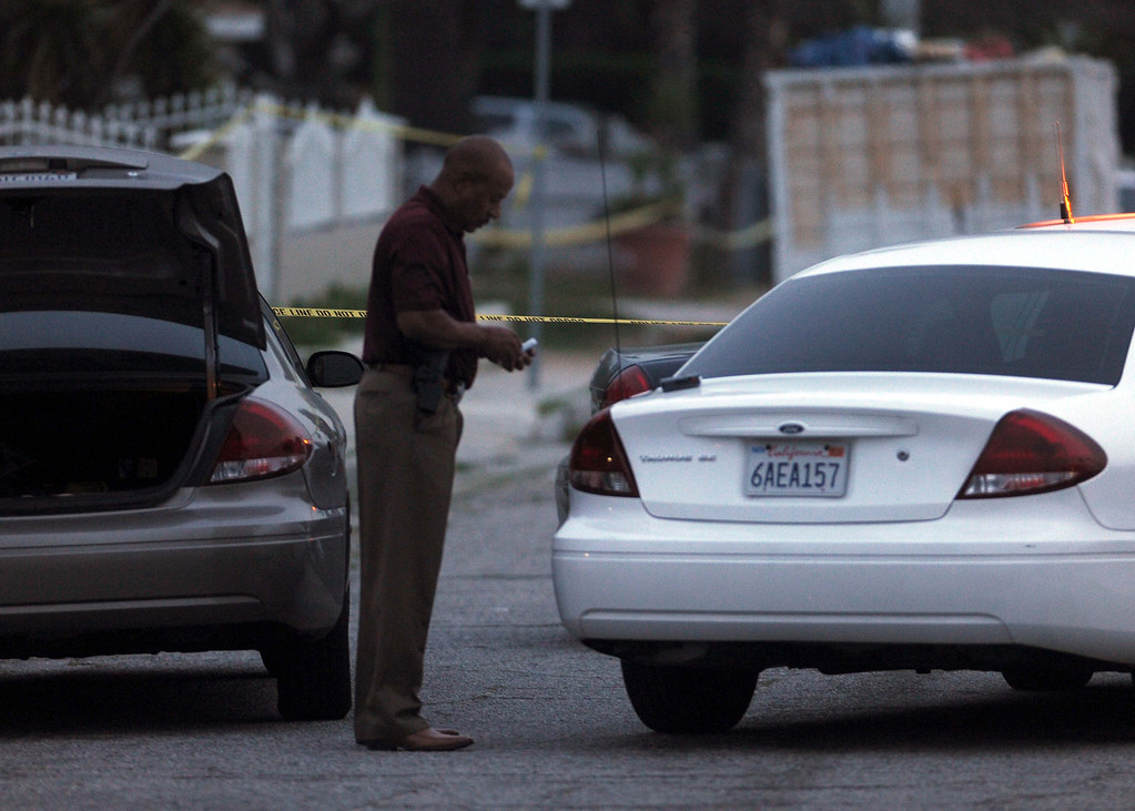 Description of . San Bernardino Police officers investigate a fatal shooting after one person was shot and killed Monday March 18, 2013 in the 2900  block of Loma Avenue in San Bernardino.LaFonzo Carter/ Staff Photographer