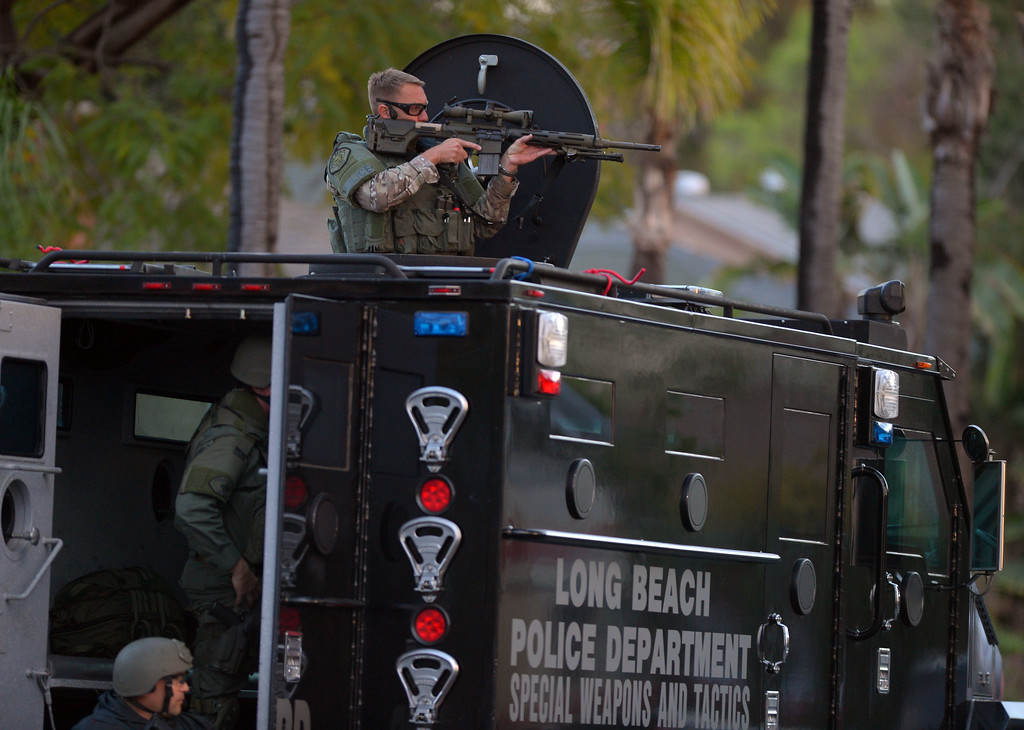 . LBPD SWAT officers stage as Signal Hill and Long Beach police search for a suspect in the area of 20th St and St Louis Ave. in SIGNAL HILL, CA on Friday, February 28, 2014.  (Photo by Scott Varley, Daily Breeze)