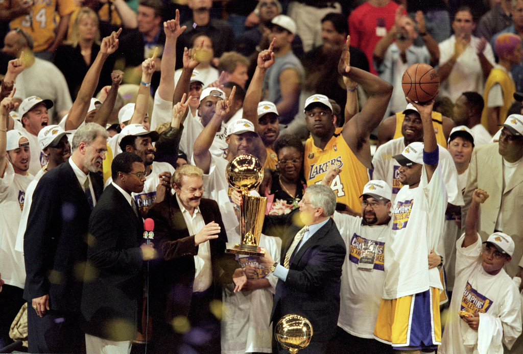 . 19 Jun 2000:  Commissioner David Stern presents Owner of the Los Angeles Lakers Jerry Buss the NBA Championship trophy in action during the NBA Finals Game 6 against the Indiana Pacers at the Conseco Fieldhouse in Indianapolis, Indiana.  The Lakers defeated the Pacers 116-111.   (Ezra O. Shaw  /Allsport)