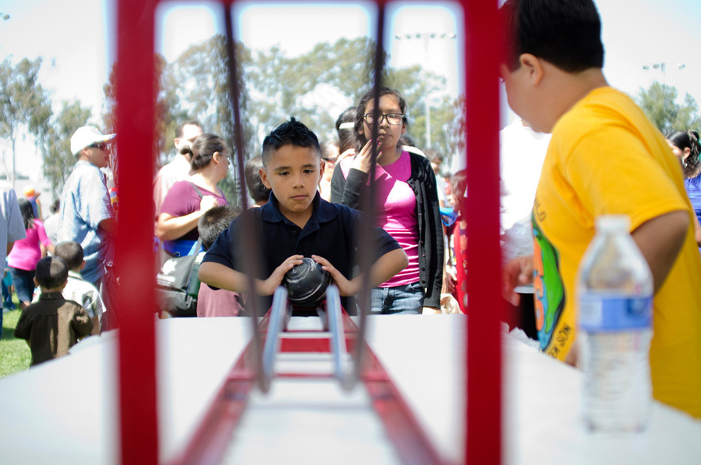 Description of . Zayd Ceron, 9, of Whittier plays a game during the first Easter Land event at Mayberry Park in South Whittier, Calif. Saturday, March 20, 2013. An Easter egg hunt, food, games and music were made available for attendees. (SGVN/Correspondent photo by Anibal Ortiz)