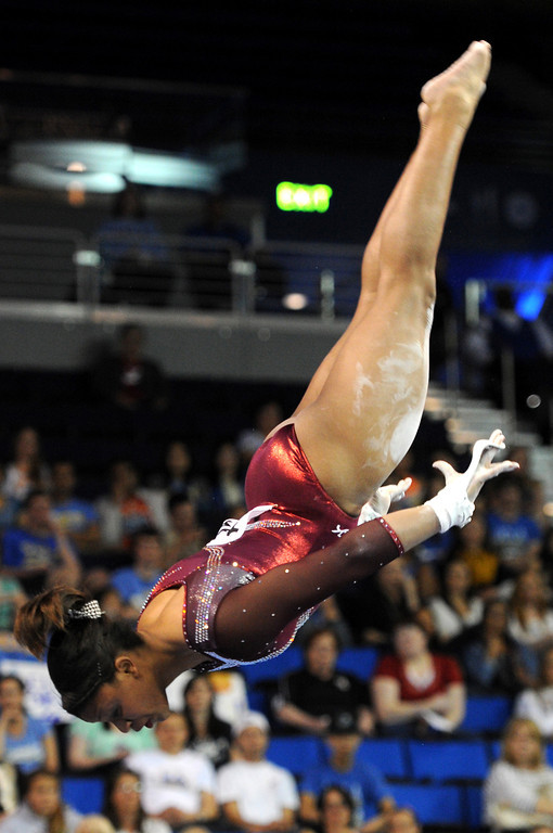 . Alabama\'s Ashley Sledge competes in the uneven parallel bars Friday, April 19, 2013, at the NCAA Women\'s Gymnastics Championships at Pauley Pavilion. (Michael Owen Baker/Staff Photographer)