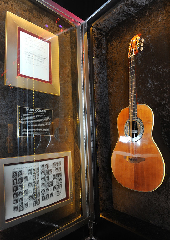 ". A Nirvana Ovation acoustic guitar played by Kurt Cobain is displayed at the launch of Hard Rock International\'s traveling music memorabilia collection, ""Gone Too Soon,\"" Wednesday, Feb. 13, 2013, at Hard Rock Cafe New York.   \""Gone Too Soon\"" pays tribute to music icons whose lives and career where tragically cut short and will be on tour at Hard Rock locations in the U.S. throughout 2013. (Photo by Diane Bondareff/Invision for Hard Rock International/AP Images)"