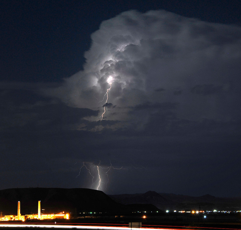 . Lightning strikes and lights up the skies as monsoon storms pass throughout the high deserts area early Monday morning, Aug. 19, 2013 - Barstow CA. Photo by Gene Blevins/LA Daily News