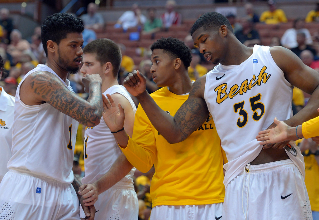 . LBSU\'s Tyler Lamb is pulled from the game after scoring 13 points at the Honda Center in Anaheim, CA on Thursday, March 13, 2014. Long Beach State vs CSU Fullerton in the Big West men\'s basketball tournament. 2nd half. LBSU won 66-56.  Photo by Scott Varley, Daily Breeze)