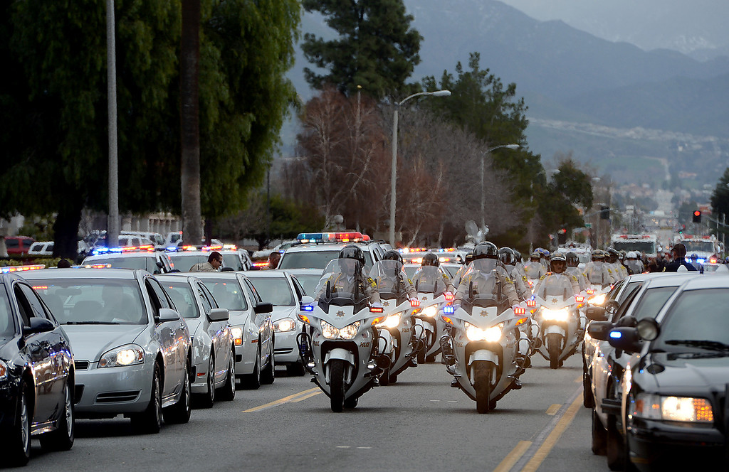 Description of . Law enforcement and fire agency officials from around California and at least three other states get ready to form the funeral procession for San Bernardino Sheriff's Detective Jeremiah MacKay Thursday February 21, 2013 at Mt View Cemetery in San Bernardino.