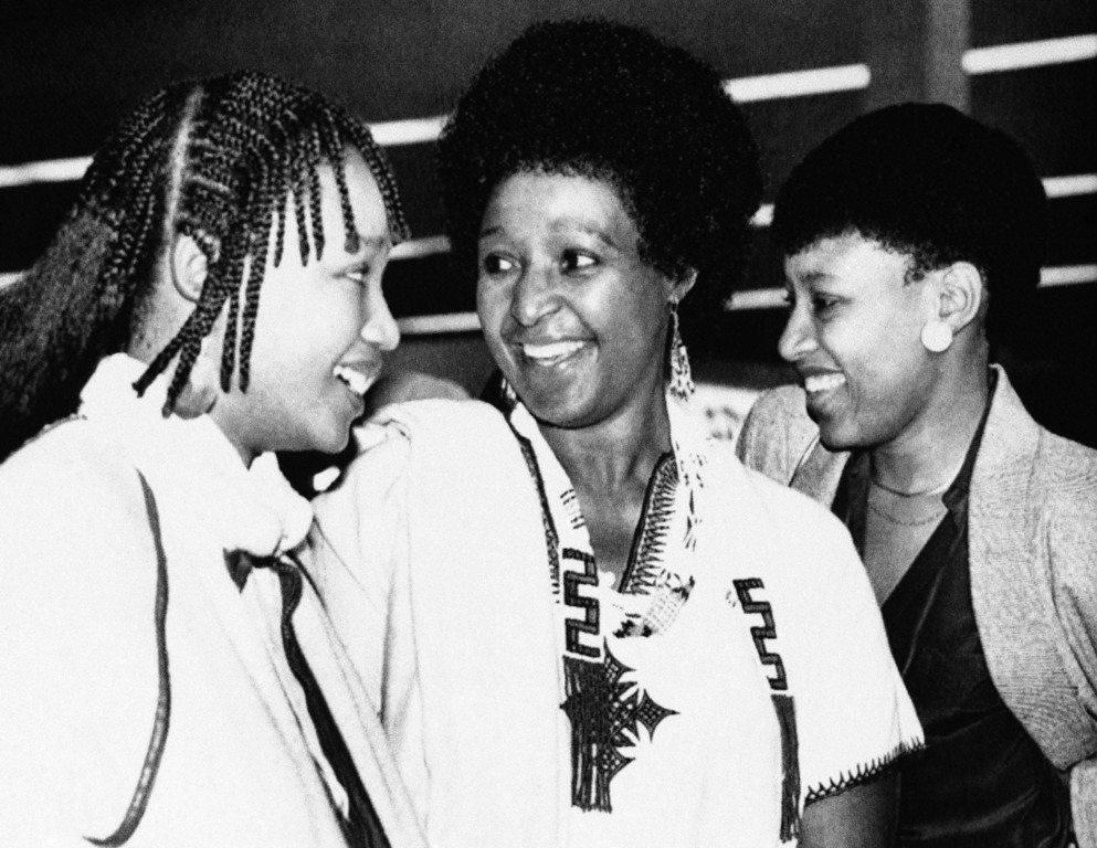 . Winnie Mandela, with daughters Dlamini, left, and Zinzi, right, arrives at Cape Town?s airport on Wednesday, Sept. 11, 1985 on her way to visit her imprisoned husband, anti-apartheid activist Nelson Mandela. (AP Photo/Greg English)