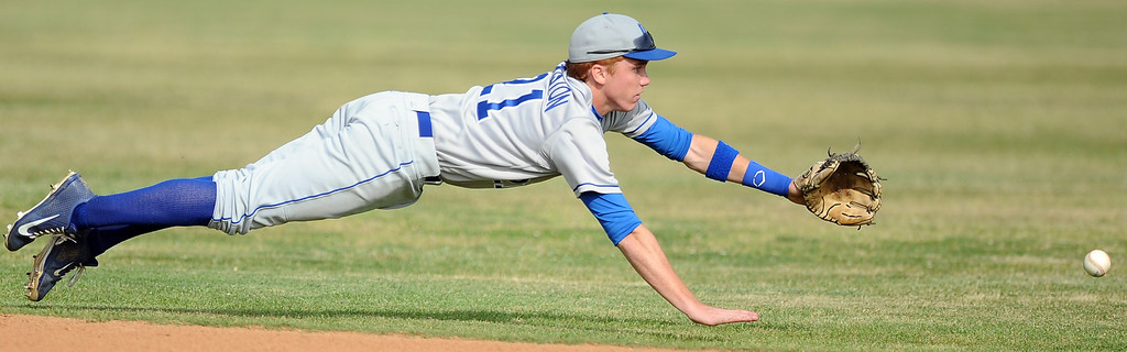 . Los Altos shortstop Jacob Blackiston can\'t come-up with a base hit by Diamond Bar\'s Casey Kernohan (C) (not pictured) in the third inning of a prep baseball game at Diamond Bar High School on Wednesday, March 20, 2013 in Diamond Bar, Calif. Diamond Bar won 9-1. (Keith Birmingham Pasadena Star-News)