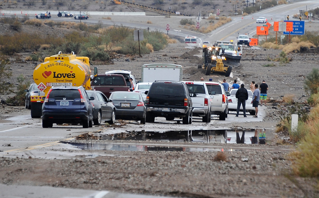 . Drivers in cars and semi trucks got stuck on highway 95 just north of highway 40 west of Needles California Sunday afternoon Aug 25th. Drivers were stuck for hours until Caltrans arrived late in the evening to start to remove the mud that came from heavy monsoon storms today in the deserts areas. Needles CA, Aug 25,2013. Photo by Gene Blevins/LA Daily News