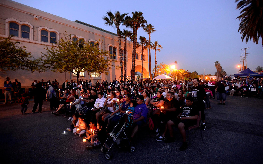 Description of . About 225 people attended the annual Victims Candlelight Vigil at the police station in San Bernardino April 23, 2013.   GABRIEL LUIS ACOSTA/STAFF PHOTOGRAPHER.