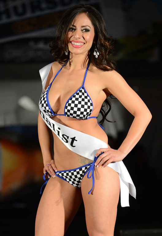 . Long Beach, Calif., -- 04-18-13-  Finalist Jeanette Serrano competes in the 2013 Tecate Light Miss Toyota Grand Prix of Long Beach  pageant Thursday night on Pine Avenue at the Tecate Light Thunder Thursday on Pine.   Stephen Carr/  Los Angeles Newspaper Group