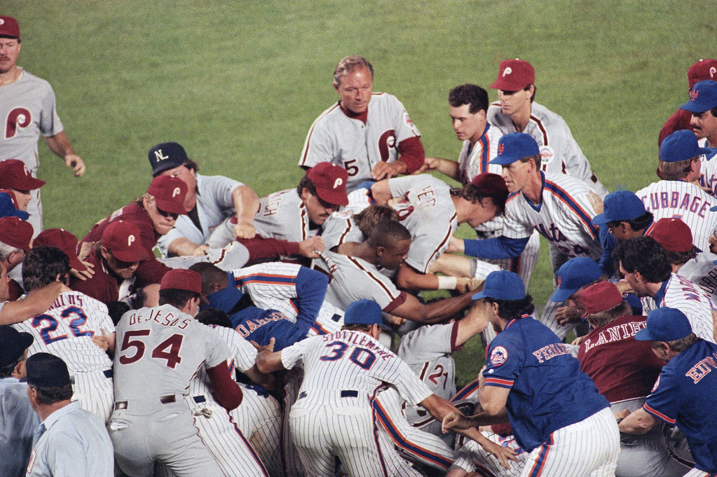 . After New York Mets pitcher Dwight Gooden was hit by a ball thrown by Philadelphia Phillies pitcher Pat Combs in the fifth inning, both teams got into a brawl at Shea Stadium, Thursday, Aug. 9, 1990, New York. The umpires ejected four Phillies and three Mets. The group is unidentified. (AP Photo/Lou Requene)