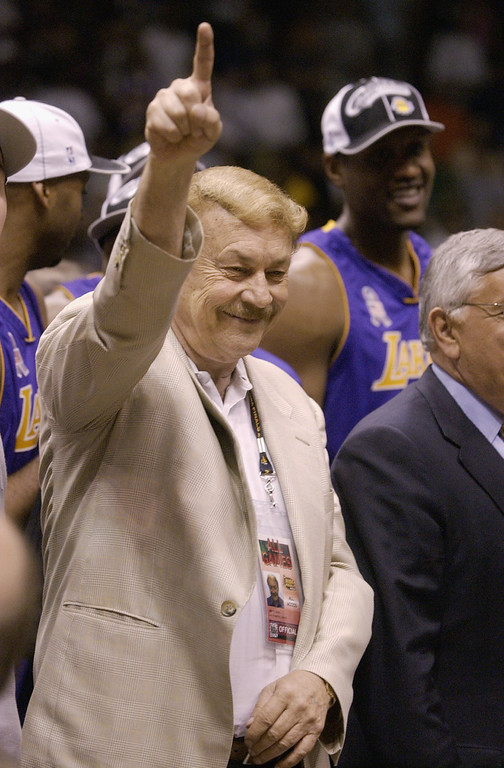 Description of . EAST RUTHERFORD, NJ - JUNE 12:  Lakers Owner Dr. Jerry Buss celebrates after defeating the New Jersey Nets in Game four of the 2002 NBA Finals at Continental Airlines Arena in East Rutherford, New Jersey on June 12, 2002. The Lakers won 112-106 to sweep the series and take the 2002 championship title.  NOTE TO USER: User expressly acknowledges and agrees that, by downloading and/or using this Photograph, User is consenting to the terms and conditions of the Getty Images License Agreement.  Mandatory copyright notice: Copyright 2002 NBAE  (Photo by Ezra Shaw/Getty Images)