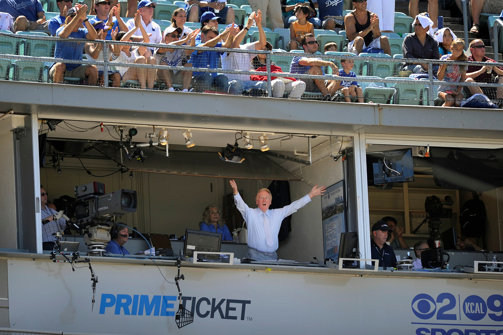 . Dodgers announcer Vin Scully waves to the crowd after it was announced he will return to the booth in 2013. (Michael Owen Baker/Staff Photographer)