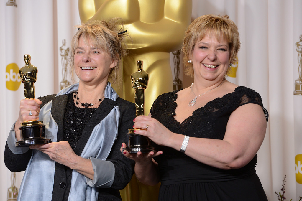 """. Julie Dartnell and Lisa Westcott accept the award for best makeup and hairstyling for \""""Les Miserables\"""" backstage at the 85th Academy Awards at the Dolby Theatre in Los Angeles, California on Sunday Feb. 24, 2013 ( David Crane, staff photographer)"""