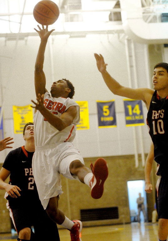 . 03-12-2013--(LANG Staff Photo by Sean Hiller)-Serra\'s Ellis Salahuddin is fouled by Pacific Hills\' Adfam Plax in Tuesday\'s boys basketball IV Southern California Regional semifinal at L.A. Southwest College.