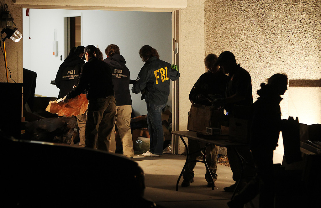 Description of . FBI agents gather at the home of Christopher Jordan Dorner while conducting a search in Las Vegas on Feb. 7, 2013.  (Jason Bean/Las Vegas Review-Journal)
