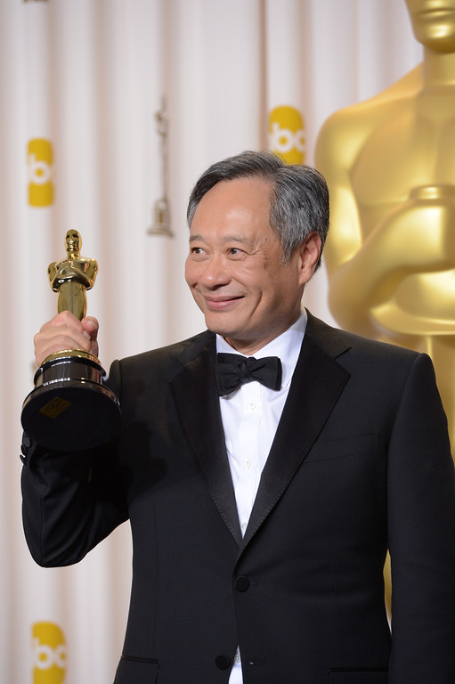 """. Ang Lee poses with his award for best directing for \""""Life of Pi\"""" backstage at the 85th Academy Awards at the Dolby Theatre in Los Angeles, California on Sunday Feb. 24, 2013 ( David Crane, staff photographer)"""
