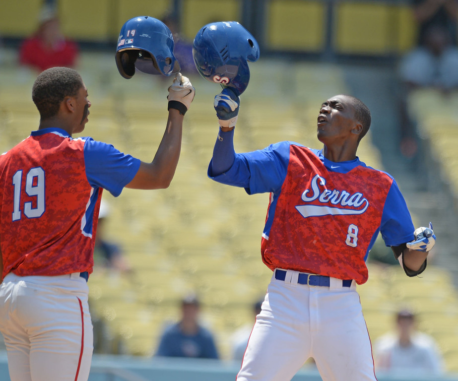 . Serra\'s Marcus Wilson (8) celebrates at home with Solemon Bates (19) after Wilson hit a home run against Mira Costa in the CIF-SS Division III championship baseball game Friday at Dodger Stadium. Serra won the title, 8-1. 20130531 Photo by Steve McCrank / Staff Photographer