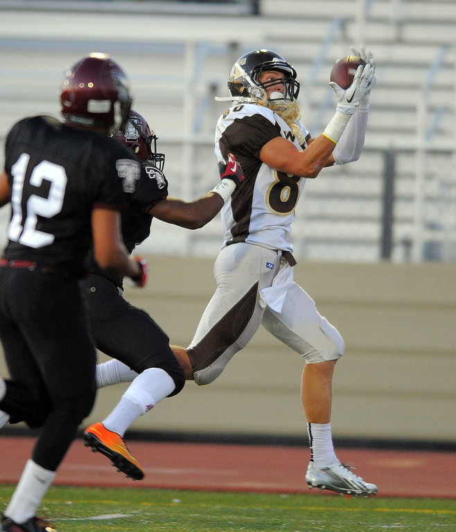 . West High takes on Torrance in a non league football game at Zamperini Stadium in Torrance, CA on Thursday, September 12, 2013. West receiver Craig Knaus hauls in a long pass which set up a 2-yard TD run on the next play. (Photo by Scott Varley, Daily Breeze)