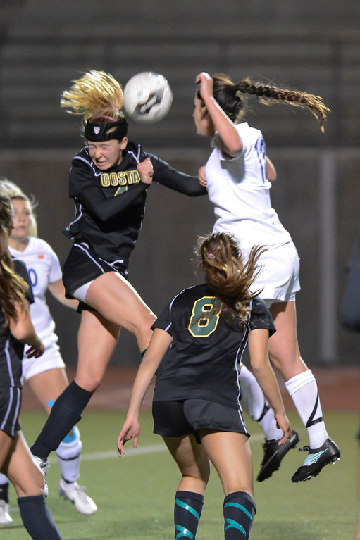. Mira Costa\'s Julia Empey and Westlake\'s Kaitlin Kimball go for a header  during quarterfinal action.  Westlake defeated Mira Costa 1-0 in the quarterfinal.  Photo by David Crane/Staff Photographer