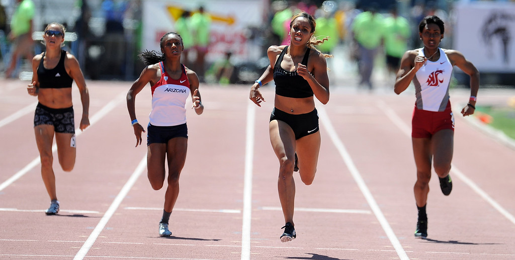 Description of . Carol Rodriguez, second from right, wins the 400 meter dash Invite Elite during the Mt. SAC Relays in Hilmer Lodge Stadium on the campus of Mt. San Antonio College on Saturday, April 20, 2012 in Walnut, Calif.    (Keith Birmingham/Pasadena Star-News)