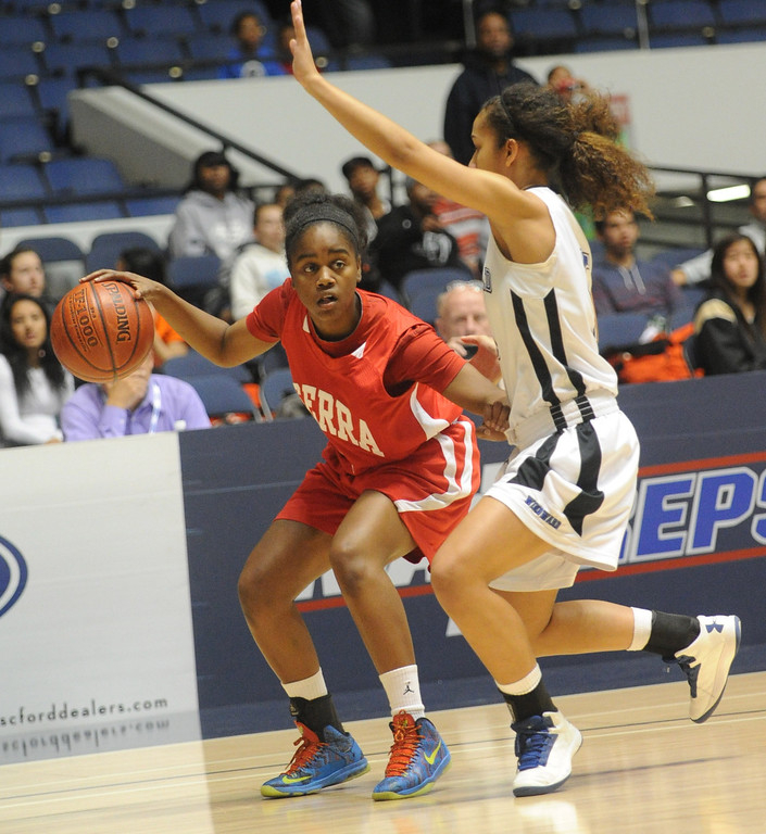 . 02-27-2012--(LANG Staff Photo by Sean Hiller)- Serra vs. Windward in Wednesday\'s girls basketball CIF SS Div. 4AA title game at the Anaheim Convention Center Arena in Anaheim. Serra\'s Siera Thompson (3) drives against Windward\'s Macchiati Smith (5).