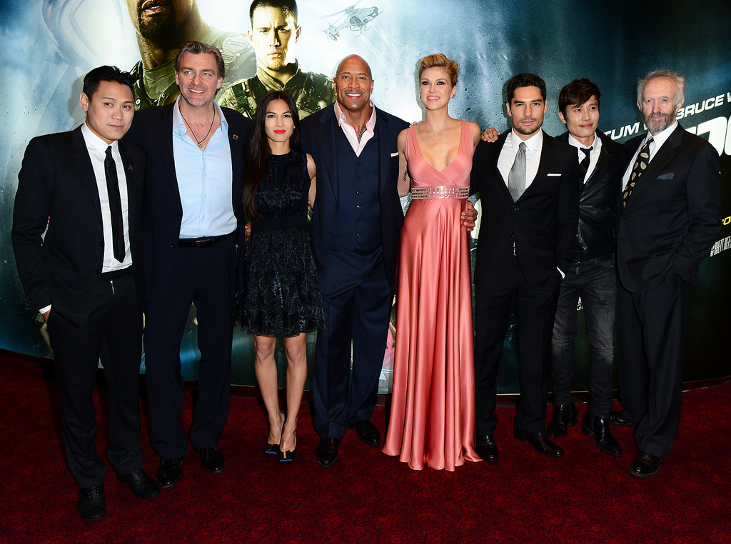 ". From left, Jon M.Chu, Ray Stevenson, Elodie Yung, Dwayne Johnson, Adrianne Palicki, D.J. Cotrona, Byung Hun-Lee and Jonathan Pryce arrive for the premiere of ""G.I. Joe: Retaliation\"" at a cinema Leicester Square in London, Monday, March 18, 2013. (Photo by Jon Furniss/Invision/AP)"