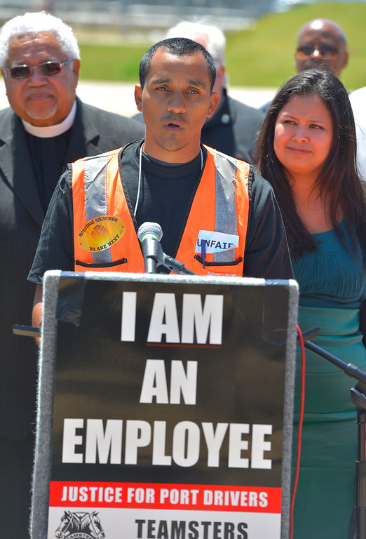 . Dennis Martiniez, a driver for Total Transportation Services, Inc., talks about his need for better wages and treatment as an employee during a press conference at Wilmington Waterfront Park in Wilmington, CA on Monday, April 28, 2014. Truckers are holding a 48-hour picket to protest treatment of drivers by three transportation companies. (Photo by Scott Varley, Daily Breeze)