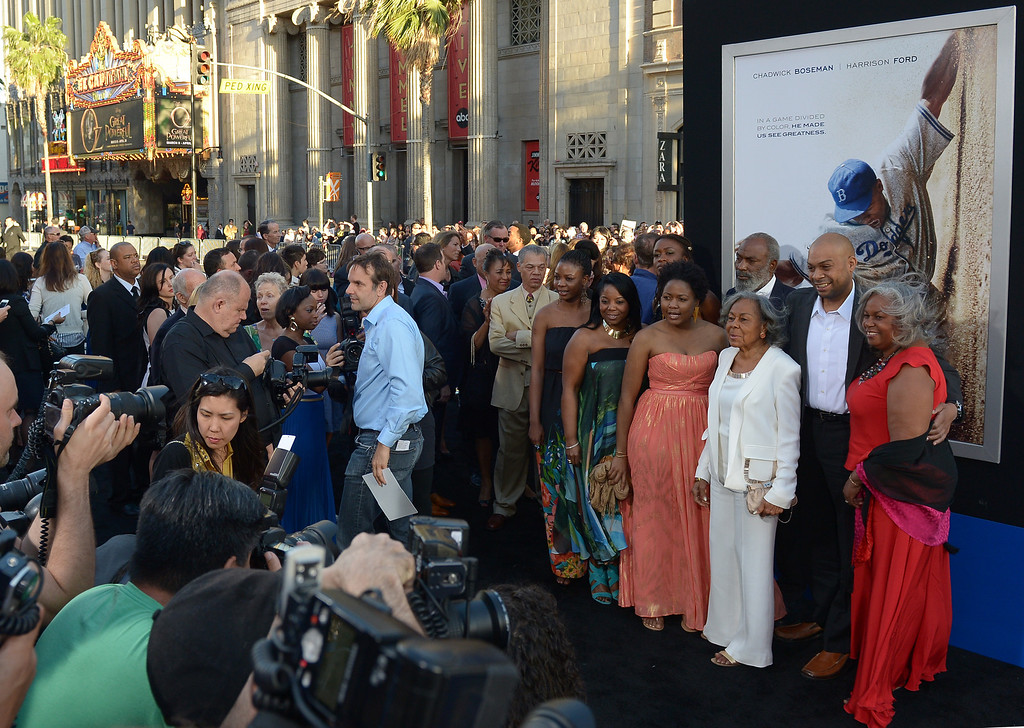 Description of . Rachel Robinson (in white), the widow of baseball legend Jackie Robinson, and her family attend the Los Angeles Premiere of Warner Bros. Pictures' and Legendary Pictures' '42' at TCL Chinese Theatre on April 9, 2013 in Hollywood, California.  (JOE KLAMAR/AFP/Getty Images)