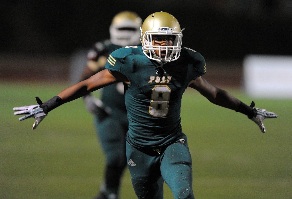 . Long Beach Poly football takes on Centennial (Corona) as part of the Mission Viejo Classic in Mission Viejo, CA on Friday, September 13, 2013. Long Beach Poly won 35-28.  Poly safety Iman Marshall celebrates a turnover on downs in the final seconds of the game. (Photo by Scott Varley, Press-Telegram)