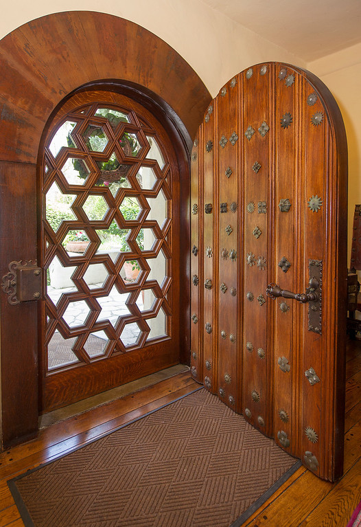 ". The front door of the La Casa Nueva, or ""the new house.\"" Built between 1922 and 1927, this 12,400-square-foot Spanish Colonial Revival mansion is noted for its fine architectural crafts, including stained glass, ceramic tile, wrought iron, and carved wood. La Casa Nueva, or \""the new house.\"" The Homestead Museum will honor seven of its volunteers, all local La Puente and Hacienda Heights residents, at its annual Volunteer Appreciation Dinner on Sat., April 6. The volunteers have given more than 4,700 hours of their time to the museum giving tours of the historic homes and properties as well as during the museum\'s festivals, workshops, youth programs and more. The volunteers to be honored are well trained docents with several years of experience. Carol Hamilton (1,000 hrs) and Eldon Dunn (6,000 hrs) of Hacienda Heights. (SGVN/Photo by Walt Mancini/Highlanders)"