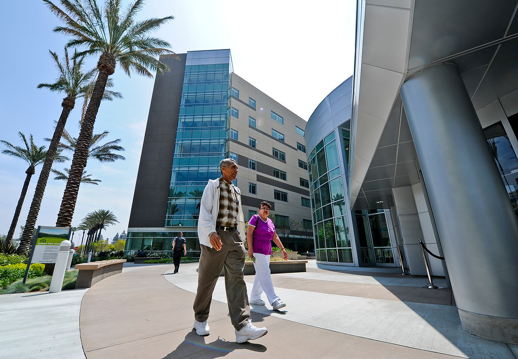 . Husband and wife Pedro and Leonor Heredia, both 65, of Rialto, walk outside the new Kaiser hospital before taking an inside tour of the facility at Kaiser Fontana\'a open house event on Saturday, April 13, 2013. (Rachel Luna / Staff Photographer)