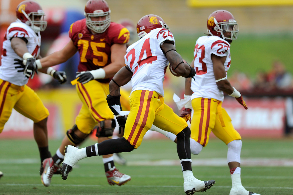 . Safety Demetrius Wright returns an interception at USC\'s Spring Football Game. (Michael Owen Baker/Staff Photographer)