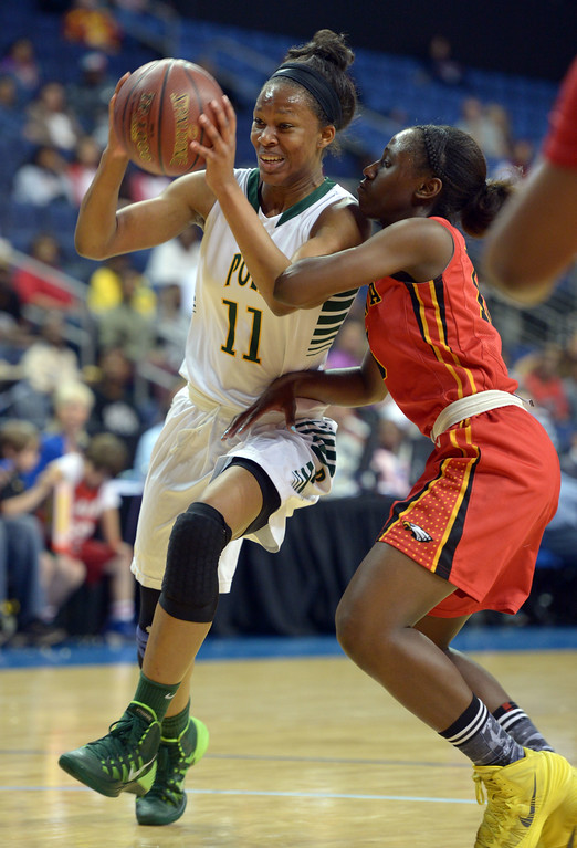 . Poly\'s Lajahna Drummer drives to the basket at Citizens Business Bank Arena in Ontario, CA on Saturday, March 22, 2014. Long Beach Poly vs Etiwanda in the CIF girls open division regional final. 1st half, Photo by Scott Varley, Daily Breeze)