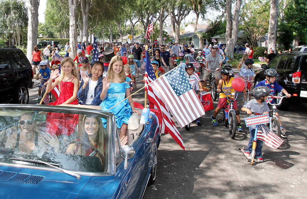 . July 4, 2013-PHoto by Tracey Roman/for the Press-Telegram  Malerie Hurley, Alex Lam, and Allie Stone ride in the lead car of the annual Los Altos 4th of July bike Parade early Thursday morning.
