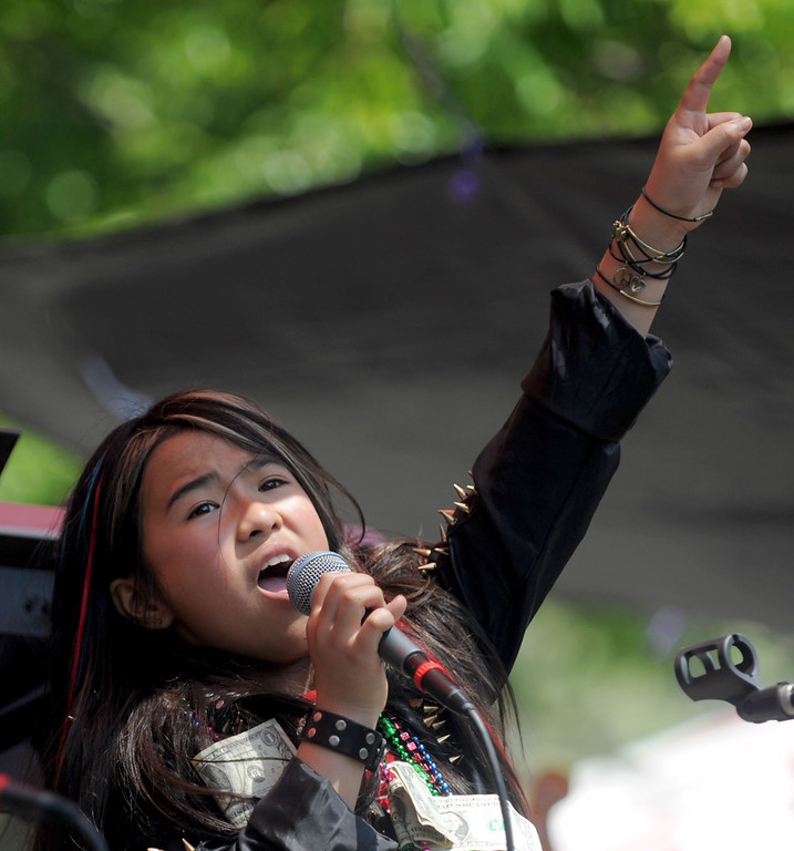 . 04-27-2013-(LANG Staff Photo by Sean Hiller)- Vanida Lekha,11, rocks out with the band Star Rat at the Cambodian New Year Celebration at El Dorado Park in Long Beach. The Cambodian community celebrated the year of the snake with Khmer traditional ceremonies, traditional and modern performances, live bands and famous Khmer singers performing throughout the day.