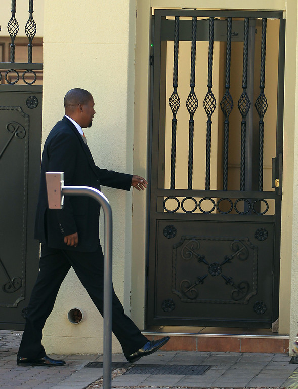 . Nelson Mandela\'s grandson Mandla Mandela arrives a his grandfather\'s residence in Johannesburg, South Africa, Wednesday, June 12, 2013. Mandela, remains in the hospital for a fifth day. The 94-year-old icon was hospitalized on Saturday for a recurring lung infection. (AP Photo/Themba Hadebe)