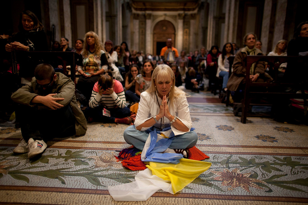 . Some of the faithful pray inside the Metropolitan Cathedral before Pope Francis  installation Mass in Buenos Aires, Argentina, Tuesday, March 19, 2013. Argentine\'s former cardinal Jorge Mario Bergoglio was chosen as leader of the Catholic Church on March 13. (AP Photo/Natacha Pisarenko)