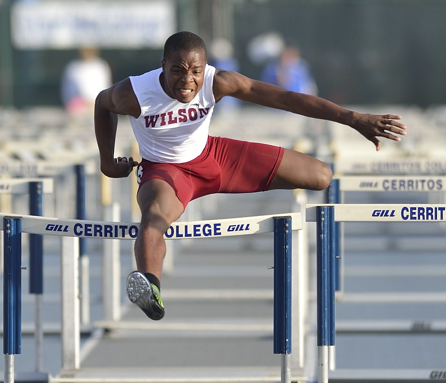 . NORWALK, CALIF. USA -- Wilson\'s Bayron Manuel competes in the 110 hurdles during the CIF-SS Masters Track and Field Meet in Norwalk, Calif., on Friday, May 24, 2013. Photo by Jeff Gritchen / Los Angeles Newspaper Group