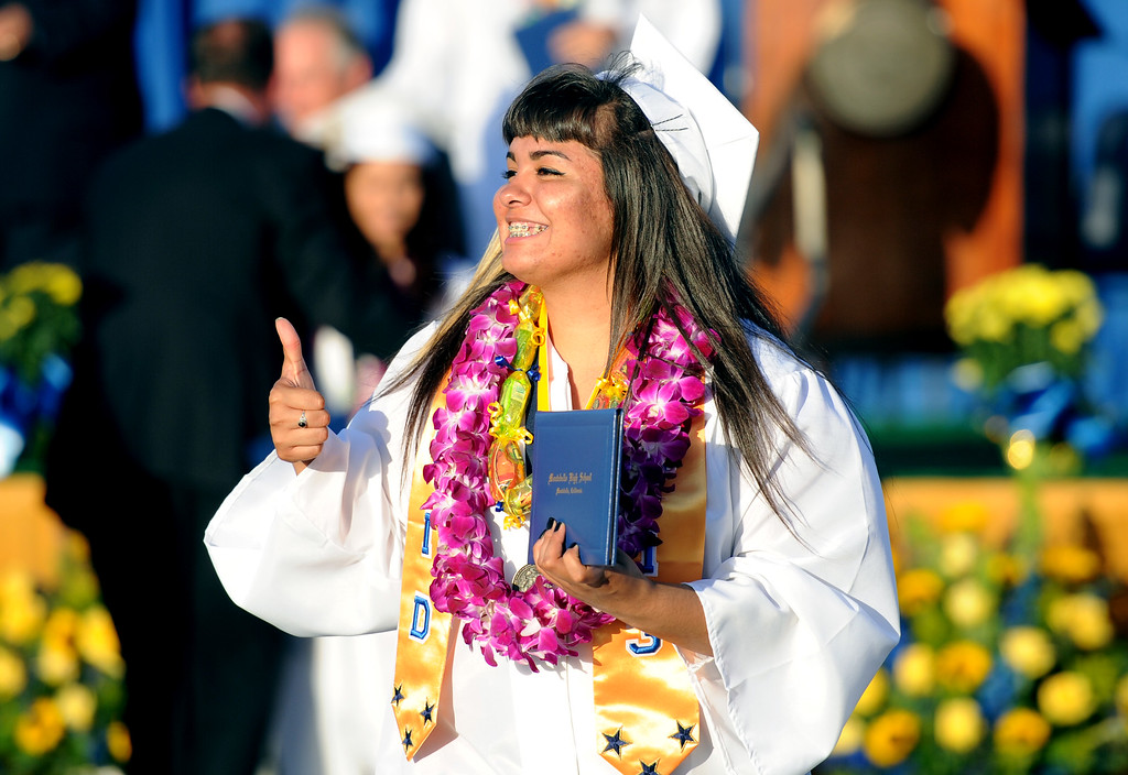 Description of . A graduate gives the thumbs-up after receiving her diploma during the Montebello High School commencement at Montebello High School on Thursday, June 20, 2013 in Montebello, Calif.  (Keith Birmingham/Pasadena Star-News)