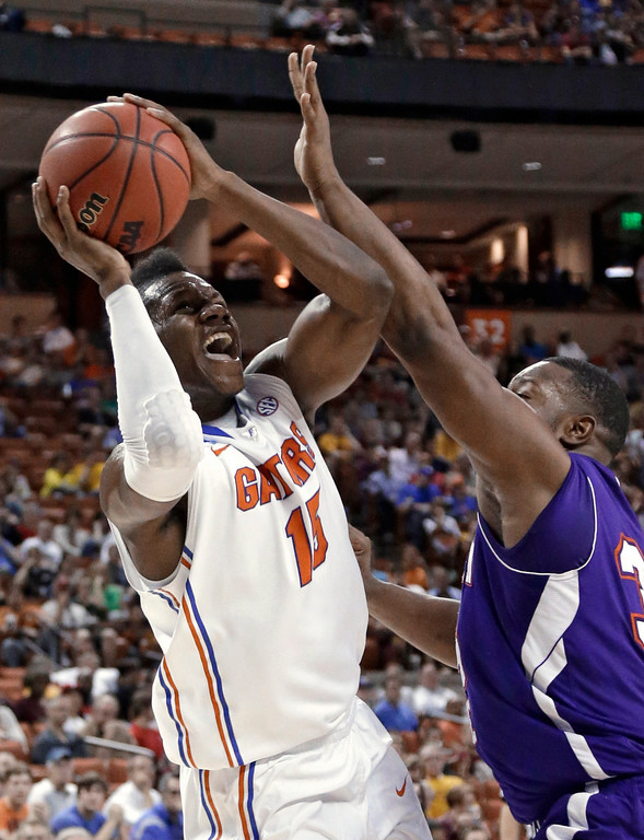 . Florida\'s Will Yeguete (15) shoots as Northwestern State\'s Gary Roberson defends during the first half of a second-round game of the NCAA men\'s college basketball tournament Friday, March 22, 2013, in Austin, Texas. (AP Photo/David J. Phillip)