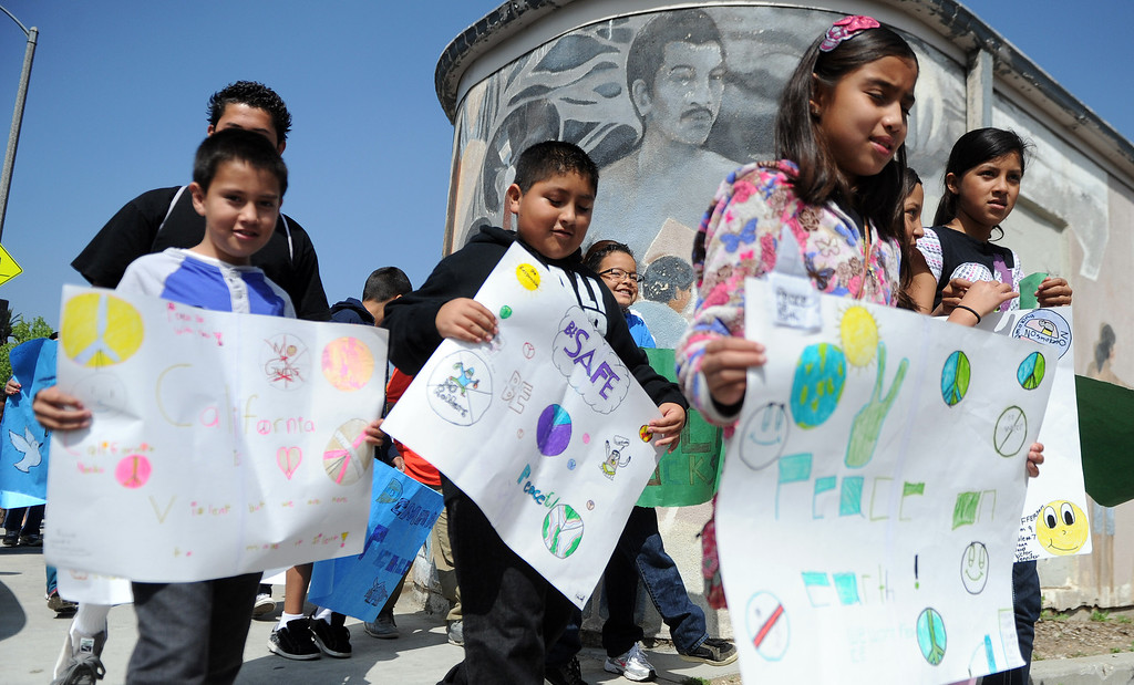 . Children march for peace during the El Centro de Accion Social Annual Cesar Chavez Commemoration and Peace Walk at the Villa-Parke Community Center on Saturday, March 30, 2013 in Pasadena, Calif.  (Keith Birmingham Pasadena Star-News)