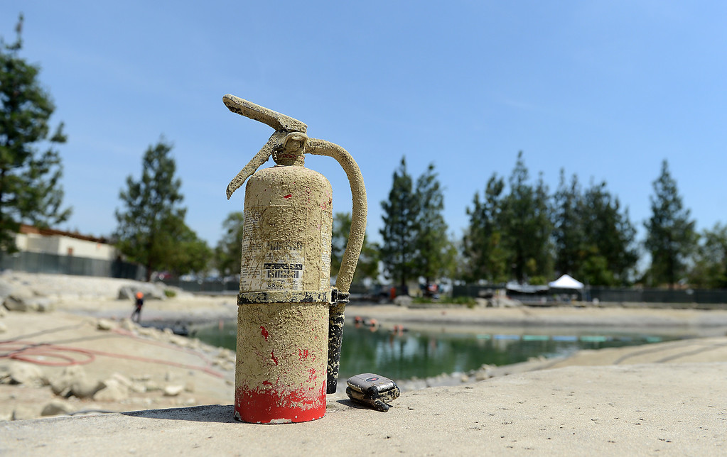 Description of . Items found in the lake at Red Hill Park in Rancho Cucamonga, CA, Friday, May 16, 2014. The city is draining the lake for cleaning and improvement of the infrastructure. (Photo by Jennifer Cappuccio Maher/Inland Valley Daily Bulletin)