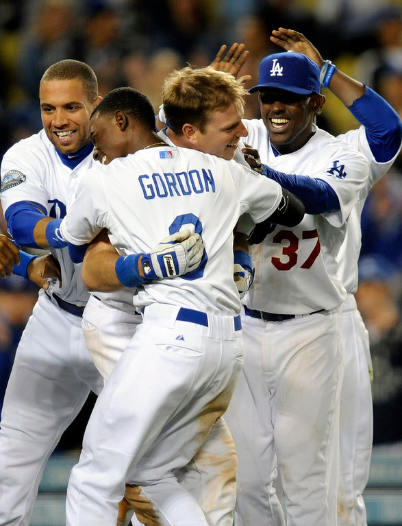. The Dodgers\' A.J. Ellis #17 is mobbed by players after his walk off homer in the bottom of the 9th inning to beat the Astros 6-3 during their game at Dodger Stadium Saturday, May 26, 2012. (Hans Gutknecht/Staff Photographer)